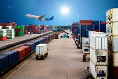 Stacker hold a container box and train freight cargo container. Stacker hold a container box and train freight cargo container Royalty Free Stock Photos