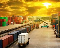 Stacker hold a container box and train freight cargo container. Stacker hold a container box and train freight cargo container Royalty Free Stock Photo