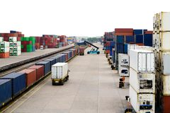 Stacker hold a container box and train freight cargo container. Stacker hold a container box and train freight cargo container Royalty Free Stock Photography