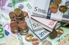 Stackes Coins and Euro Bills Stock Images