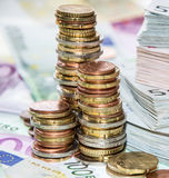 Stackes Coins and Euro Bills Stock Image