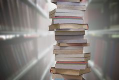 Stacking books with blur bookshelfs background in library room. Stacking books with blur bookshelfs background in the library room. Education and knowledge high royalty free stock photography