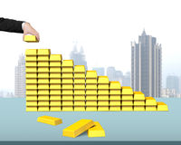 Stacking bullion in stairs shape on desk. Stacking bullion in stairs shape with city view background Royalty Free Stock Photos