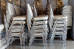 Stacking of chairs. To keep good order Stock Photo