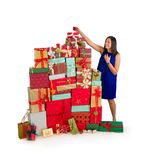 Stacking christmas presents royalty free stock images