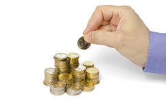 Stacking Coins. Mid adult man is stacking Euro coins Royalty Free Stock Photo