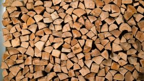 Stacking of firewood along the wall. Stop motion animation stock video footage
