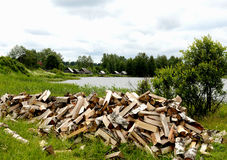 Stacking firewood. Firewood stacked on the lake Royalty Free Stock Images