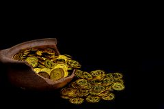 Stacking gold Coin in broken jar on black background, .Money stack for business planning investment and saving future royalty free stock photo