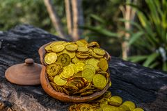 Stacking Gold Coin in jar on wooden with blurred background, Money stack for business planning investment and saving future concep royalty free stock photo