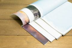 Stacking magazine place on wooden table background. Royalty Free Stock Images