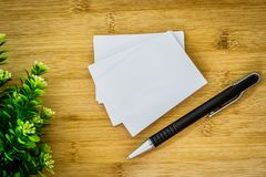 Stacking of mockup empty white business card with elegance pen stock images