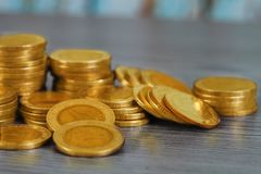 Stacking money coins on wood background,. The saving with growing up your money stock image