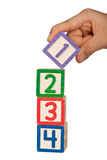 Stacking number blocks Royalty Free Stock Photo