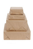 Stacking parcels boxes with kraft paper, isolated on white Stock Images