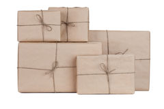 Stacking parcels boxes with kraft paper, isolated on white Royalty Free Stock Image