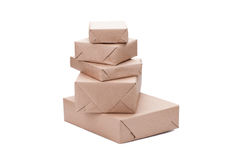 Stacking parcels boxes with kraft paper, isolated on white Stock Photography