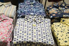 Free Stacking Shirts With Colorful Pattern On Sale In Orderly Piles In Department Store Royalty Free Stock Photography - 143876087
