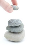 Stacking stones. Stacking pebble stones isolated on white Royalty Free Stock Photography