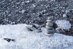 Stacking stones on iceberg Royalty Free Stock Images