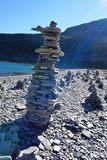 Stacking stones near Lom  Norway 2016. Stacking stones and beautiful sunbeams at a lake near Lom in Norway 2016 Stock Photo
