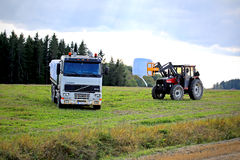 Stacking up Silage onto a Volvo FH12 Flatbed Truck royalty free stock images