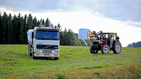 Stacking up Silage onto a Volvo FH12 Flatbed Truck Stock Image