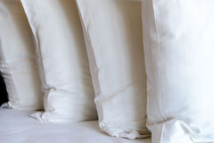 Stacking of white pillows on bed Royalty Free Stock Photo