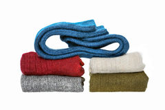 Stacking of winter wool socks. Over a white background Royalty Free Stock Photo