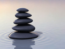 Stacking zen stones on water Stock Photo