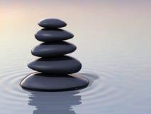Stacking zen stones on water Stock Photo