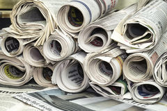 A stackof rolled newspapers Stock Photo