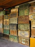 Stacks of antique turkish wood chests in warehouse. Stacks of beautiful antique turkish wood chests with faded decorations in warehouse, Istanbul, Turkey Royalty Free Stock Photography