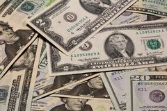 Stacks of assorted US paper currency Royalty Free Stock Images