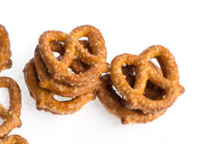 Stacks of baked pretzels on white. Close up photography of multiple stacks of baked pretzels on white royalty free stock image