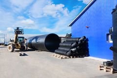 Stacks of black pvc plastic pipe outdoors with selective focus. Outside the warehouse stock photos