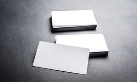 Blank white business card on grey background Stock Photography