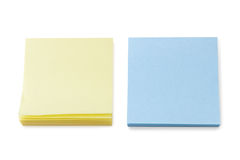 Stacks of blank yellow & blue Post-it notes Royalty Free Stock Photos