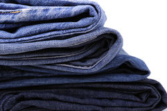 Stacks of blue jeans Stock Photography