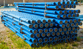 Stacks of blue PVC water pipes Royalty Free Stock Photo