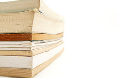 Stacks of books with white empty space. Stack of books on one side with blank white space Royalty Free Stock Image