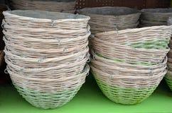Wicker baskets on shelf stock image