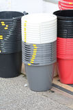 Stacks of buckets outside shop for sale for £1.25 each Stock Images