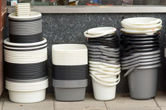 Stacks of buckets and washing-up bowls for sale Royalty Free Stock Photo