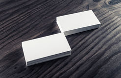 Stacks of business cards. Stacks of blank business cards on vintage wood background. Template for ID. Blank objects for placing your design Royalty Free Stock Photography
