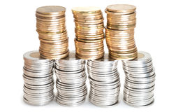 Stacks of Canadian coins. On white background Stock Images