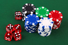Stacks of casino chips and dice Stock Photo