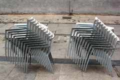 Stacks of chairs at sidewalk cafe Stock Images