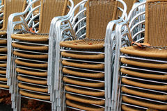 Stacks of chairs at sidewalk cafe.  Stock Photography