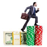Stacks of  chips and climbing businessman Royalty Free Stock Images